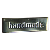 Metalen label 'Handmade'